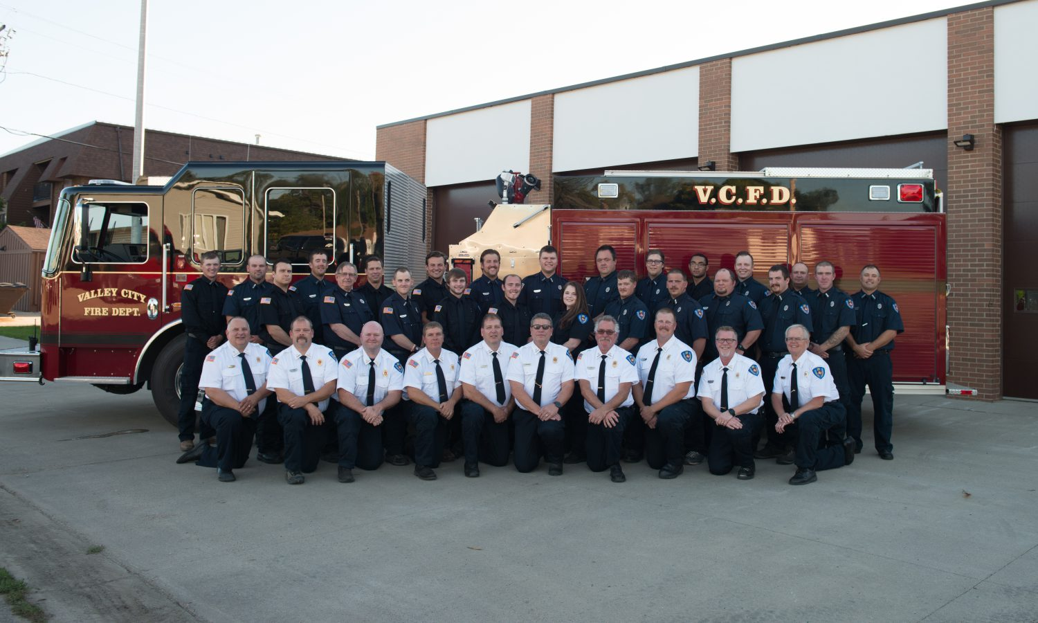 Valley City Fire Department 2019 Members in front of a red fire truck