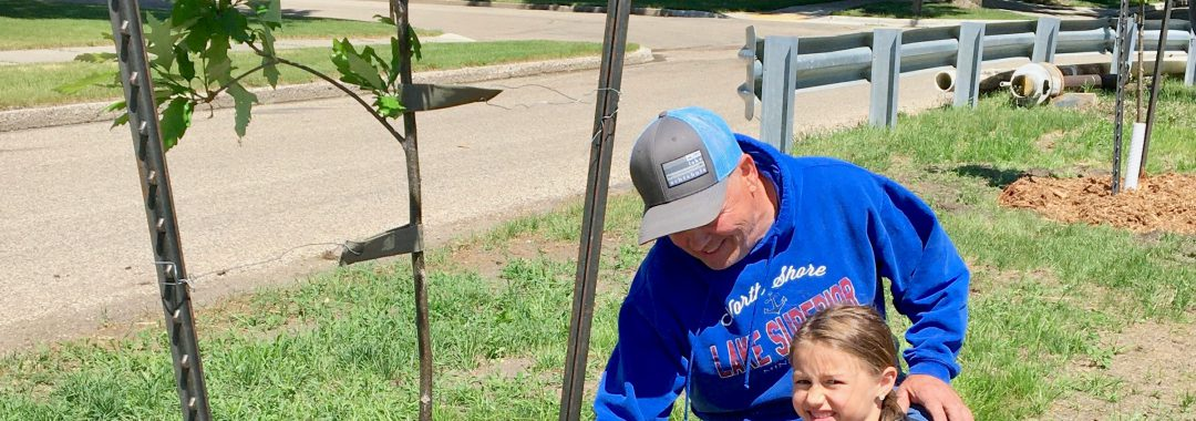 Rick Anderson and his granddaughter Emma Trapp, helped the Valley City Beautification Committee